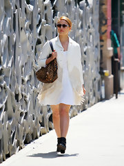 Diana Agron kept her look monochromatic and light with a fringed white coat paired over an adorable white frock.