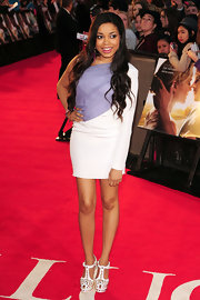 Dionne Bromfield arrived at the premiere of 'The Lucky One' in a stylish purple and white one shoulder dress.