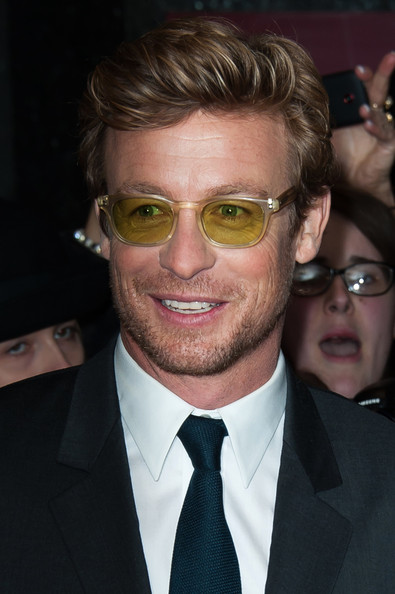 Simon Baker sported a pair of classic Wayfarers in a not-so-classic yellow color.