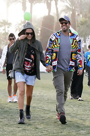 Eli Roth chose a multi-colored zip-up jacket for his funky look Coachella.