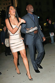 Kimora Lee dazzled in metallic pointy toe pumps. She paired the heels with a fitted body con dress.