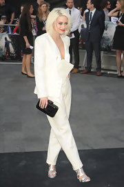 Kimberley Wyatt complemented her white pantsuit with a black hard-case clutch at the 'World War Z' premiere.