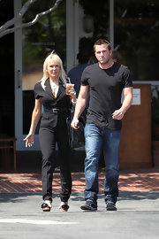 Doug wore a simple black tee while out with his mom, Kelly Roberts.