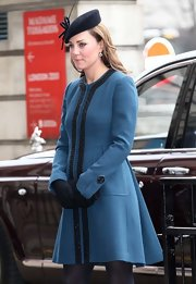 Kate Middleton has become known for her gorgeous coats, like this blue one with stylish bead embellishments.