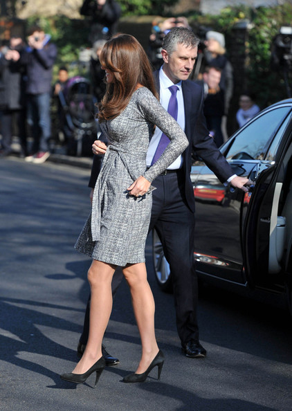 Kate Middleton Reveals Her Baby Bump in a Print Wrap Dress in London February 19, 2013