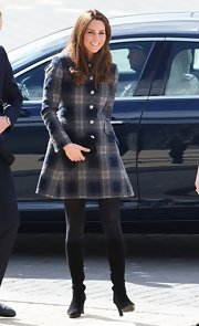 Kate Middleton stepped out sporting this fabulous new coat in a gray and navy Tartan plaid design.