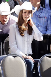 Kate was ultra chic in a white button-up shirt complete with lace detailing.