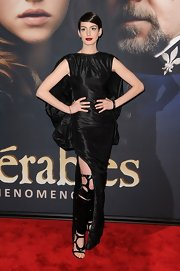 At the New York premiere of Les Miserables, Anne Hathaway accessorized her gown with black, vegan, over-the-knee, cut-out Tom Ford bondage boots.