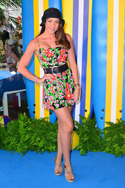 Michelle Heaton showed off her summertime style with this floral frock, which she accessorized with a wide belt and flapper-style cap.
