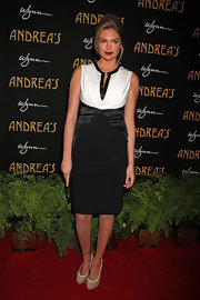 Kate Upton looked rather demure at the Andrea's opening in this black-and-white cocktail dress.