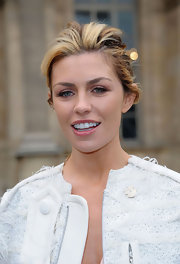 Abbey Clancy attended the Louis Vuitton fall 2012 fashion show wearing her hair in a casual updo.