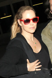 Elizabeth Berkley entered LAX wearing red-rimmed sunglasses.