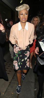 Emeli Sande mixed sporty and girlie with this peach zip-up jacket paired with a floral dress and sneakers.