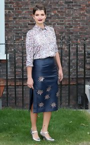 Pixie played with textures when she paired this floral button down with a deep blue leather skirt.