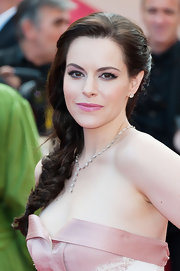 Emily Hampshire arrived at the 'Mud' premiere looking chic with her plentiful strands styled in a sleek side braid.