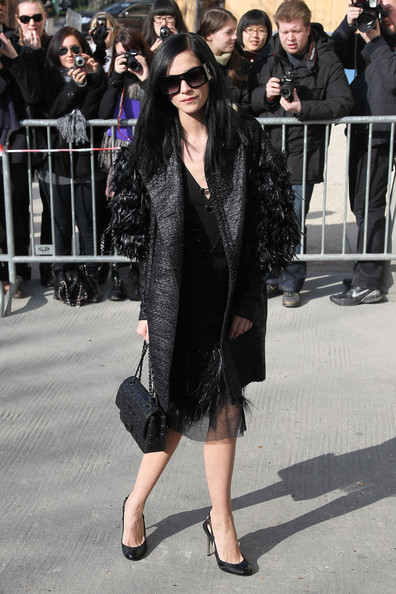 Leigh Lezark accented her head to toe Chanel attire with the brand's gray tweed classic flap bag.
