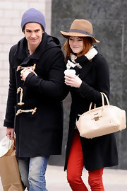 Emma Stone gave her street threads a ladylike finish with a structured cream JL Bowling bag.