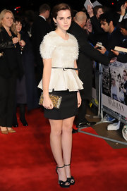Emma Watson was chic in black and white at the 'My Week with Marilyn' premiere in London. Emma topped off her peplum top with black platform sandals.