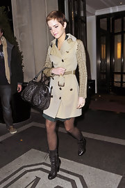 Emma wears a pair of darling polka-dot tights with her studded Burberry trench.