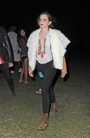 Emma Watson attended an evening performance at the Coachella Music Festival wearing a distressed pair of brown lace-up boots.