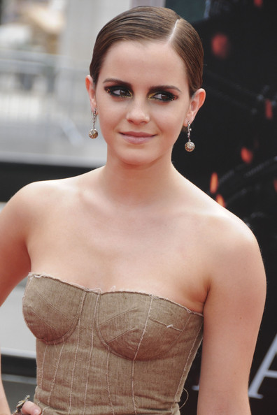 Emma Watson pulled her edgy-glam look together with a pair of Lorraine Schwartz dangling spheres.