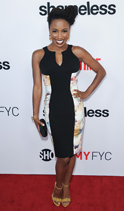 Shanola Hampton showed off her curves in a figure-flattering black dress that featured pastel panels.