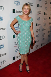 Arielle Kebbel balanced her beaded mint dress with black ankle strap heels and a matching frame clutch.