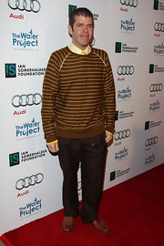 Perez Hilton went for the print-on-print look with this striped brown sweater and slacks combo.