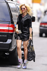 All eyes were on Rita's space-age metallic ankle-boots for her outing in Soho.