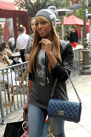 Alexandra Burke swung a quilted Chanel bag while out Christmas shopping.
