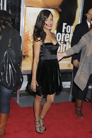 Tessa wore a pair of studded gladiator heels with a black velvet and satin cocktail dress by Versus.