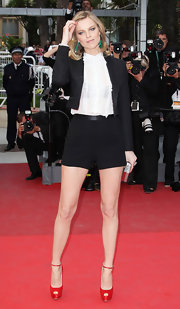 Eva wore a chic short suit with red platform pumps to the Cannes Film Festival.