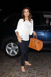 Eva Longoria showed off a chic tan Birkin while out and about in Beverly Hills.