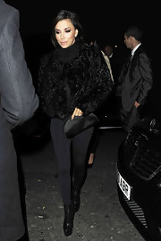 Eva Longoria embraced texture in a furry black chubby jacket and sleek leggings.