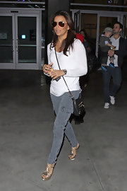 Eva Longoria added pep to her step with metallic platform T-strap sandals.