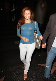 Eva stepped out with her hubby sporting a long-sleeved top with white skinny jeans and metallic accessories.