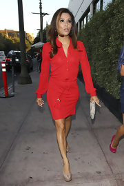 Eva Longoria accessorized her red shirtdress with nude peep-toe pumps.