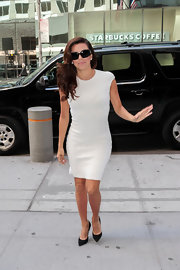 Eva Longoria kept her look simple and chic with this fitted, white dress.