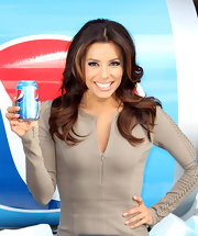 Eva Longoria attended a Pepsi event in NYC wearing her hair styled in soft voluminous waves.