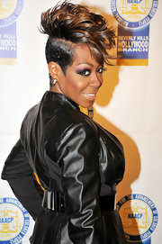 Tichina Arnold topped off her NAACP Theatre Awards look with a flamboyant fauxhawk.