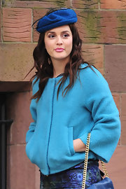 Leighton Meester donned a vibrant royal blue cap with a fishnet veil on the set of 'Gossip Girl.'