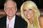 FILE PHOTO DATED August 27 2009. Playboy magnate Hugh Hefner has reportedly proposed to his Playmate girlfriend Crystal Harris with an engagement ring on Christmas Eve. ORIGINAL CAPTION Hugh Hefner and Crystal Harris with friends at Highlands in Hollywood.