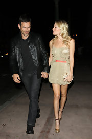 LeAnn Rimes wore gold ankle strap heels with her mini nude metallic dress.