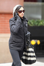 Famke Janssen strolled to the gym wearing a pair of tortoise shell framed sunglasses.