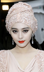 Fan Bingbing looked all to luxurious at the Elie Saab fashion show. She completed her sequined ensemble with dangling diamond and crystal earrings.