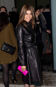 Carine Roitfeld sizzled in a fierce leather belted coat at the Jean-Paul Gaultier show.
