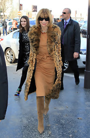 Anna wears a knee-length fur coat with a leopard print for the Celine fashion show in Paris.