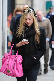 "Fearne Cotton can;t seem to get her head out of her blackberry, while leaving Radio 1 studios. She isn't hard to miss with her pink ""Hayden"" tote."