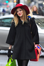 Fearne looks lovely in winter in a bright red wide brimmed hat.