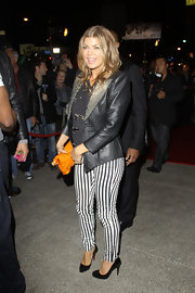 Fergie gets playful in striped pants at the 'Looks Like You Give a Damn' event in Hollywood.